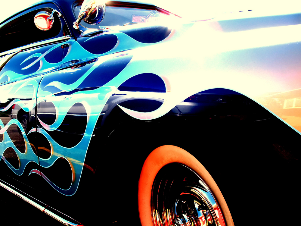A heavily modified car with flame paintwork
