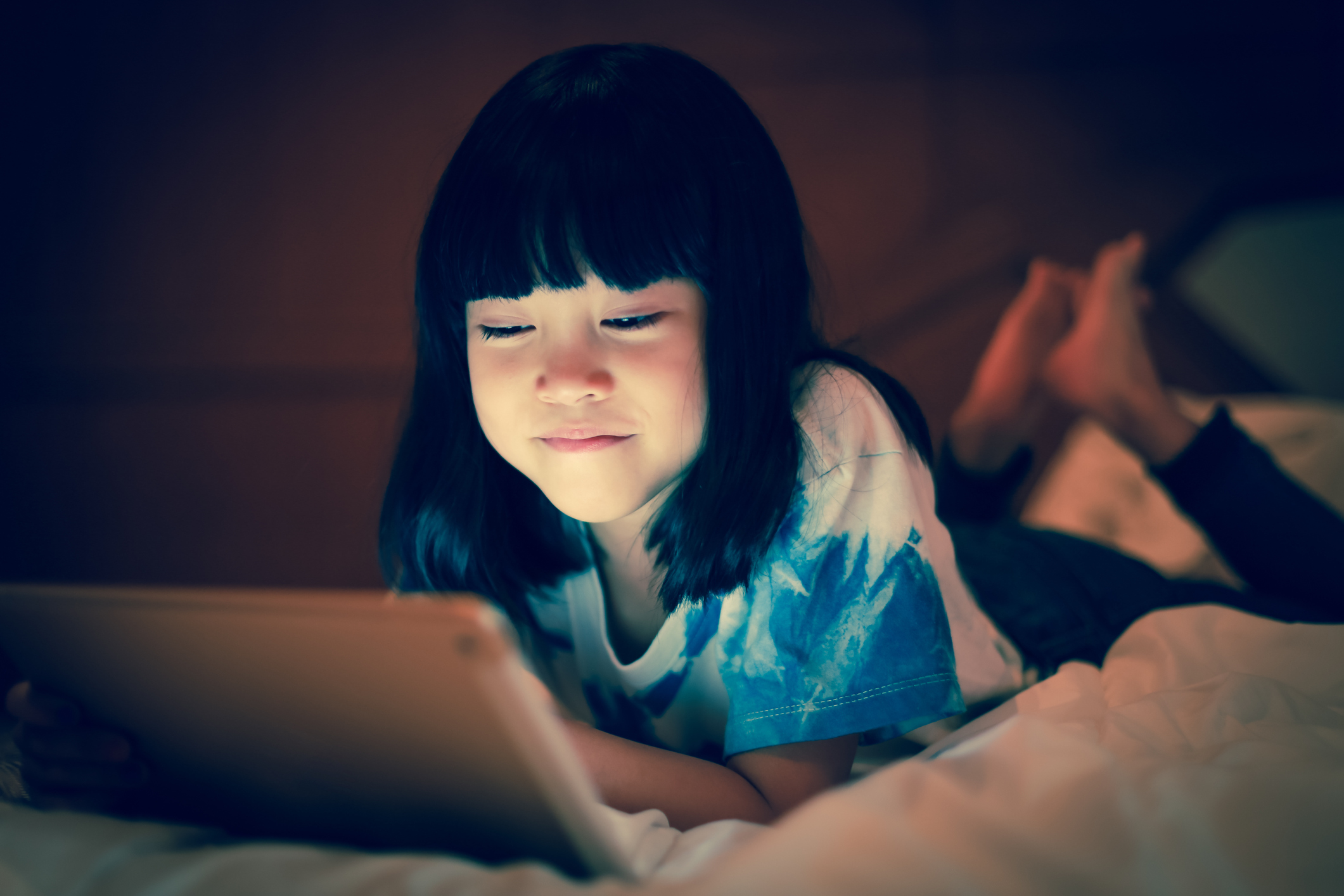 Young girl surfing the web on an iPad