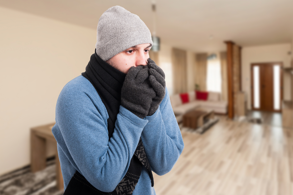 A freezing cold man with no heating due to unpaid household bills